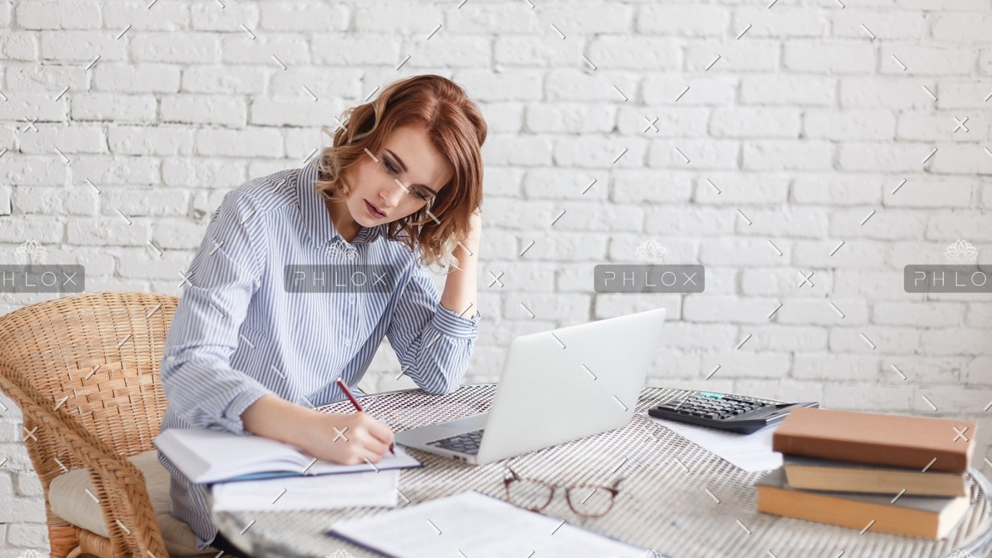 woman-freelancer-female-hands-with-pen-writing-on-P369BAX1-2